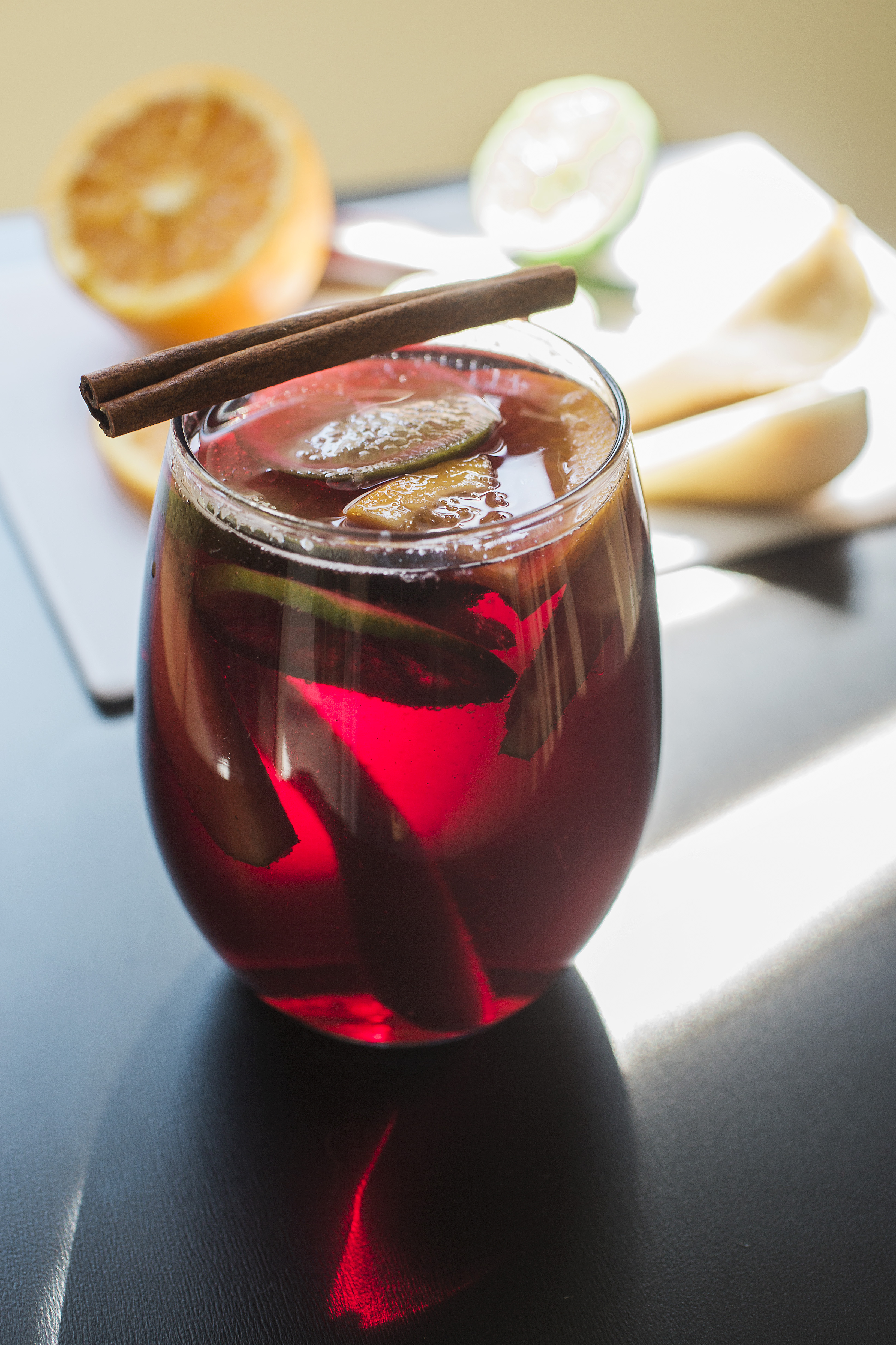 Ingredients: 1/2 cup Grand Marnier 1/4 cup Brandy 1 orange, halved and sliced 1 lime, sliced 1 pear, sliced 3 cinnamon sticks 1 bottle dry red wine 3/4 cup ginger ale Directions: Add first 7 ingredients to a large pitcher and stir well. Refrigerate for at least 2 hours. Right before serving, add ginger ale and enjoy.