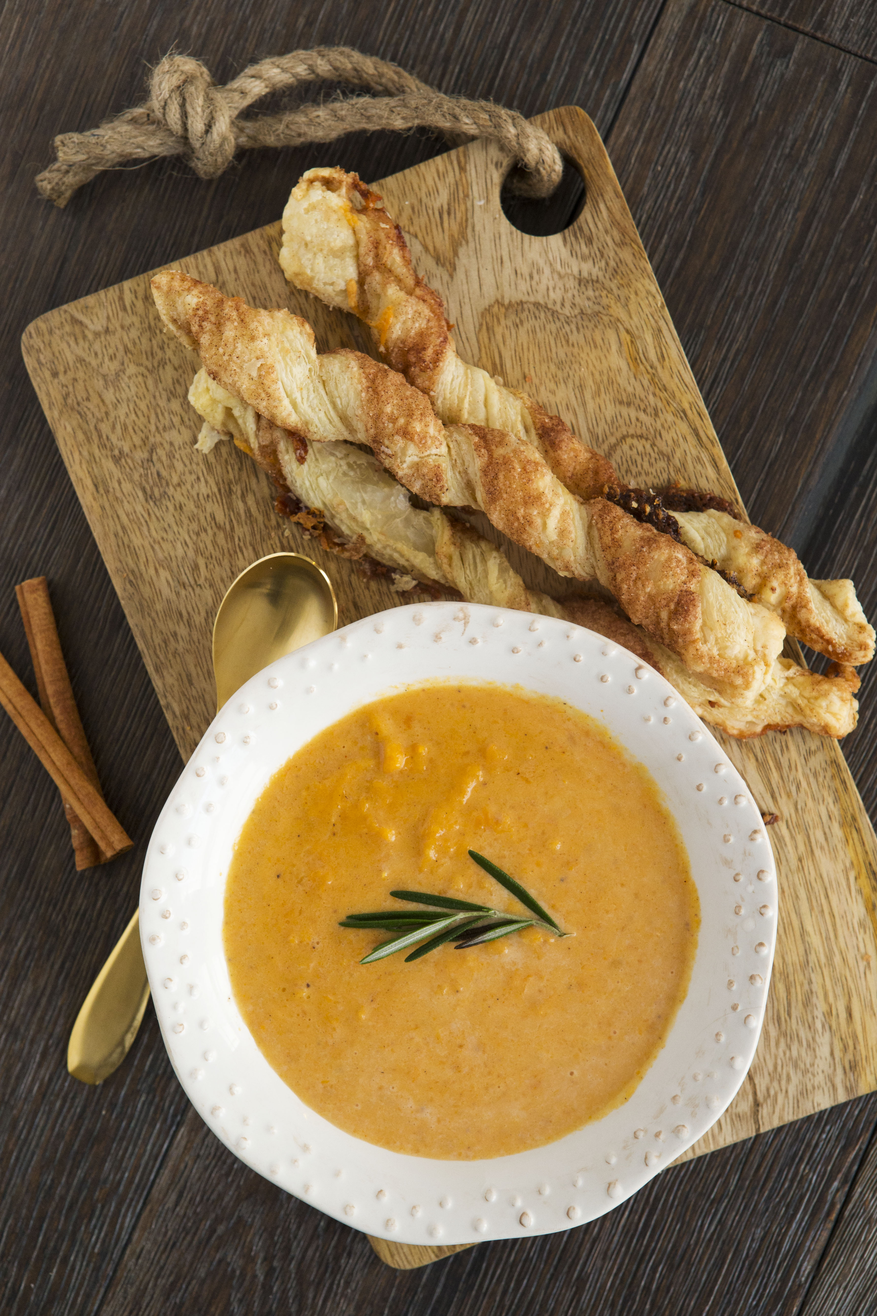 Sweet Potato Soup Ingredients: 3 to 4 sweet potatoes 1/2 cup maple syrup 1 teaspoon ground cinnamon 2 1/2 cups vegetable broth 1 cup apple cider 1/4 teaspoon nutmeg 1 cup heavy whipping cream 1/2 cup sharp cheddar cheese 2 tablespoons butter salt and pepper, to taste Directions: Bake sweet potatoes at 400 degrees for 1 hour. Meanwhile, add maple syrup and cinnamon to a large saucepan and bring to a boil. Reduce the heat and simmer for 15 minutes. The mixture should have a honey consistency. Peel the skins from the cooked sweet potatoes and add the potato to a food processor and purée with 1 cup of broth. Stir in sweet potato mixture with maple syrup mixture and add remaining broth, apple cider, nutmeg and salt and pepper. Cook over medium heat for 10 minutes. Add heavy whipping cream and cook for another 5 minutes. Then add cheese and butter and cook until cheese is melted through. Serve. Cinnamon Cheddar Twists Ingredients: 1 sheet puff pastry, thawed 1/4 cup butter, melted 2 tablespoons ground cinnamon 2 tablespoons sugar 1/2 cup of sharp cheddar cheese, shredded Directions: Preheat oven to 350 degrees. Cut puff pastry in 1 inch sections. Brush with melted butter. Mix cinnamon and sugar together and sprinkle on the buttered pastry. Sprinkle cheese on top. Take each end of the pastry and twist. Place on greased baking sheet. Cook for 10 to 15 minutes or until golden brown.